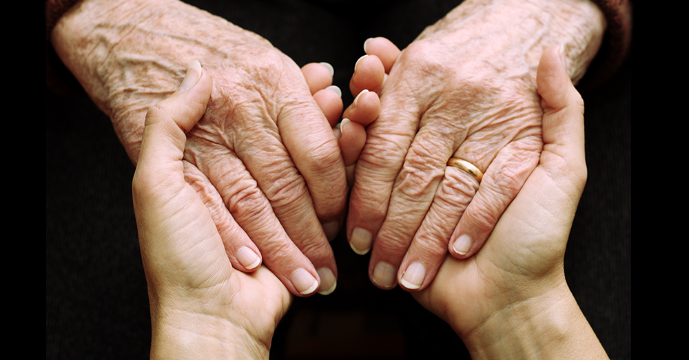 old+sick+womans+hands+with+young+womans+hand